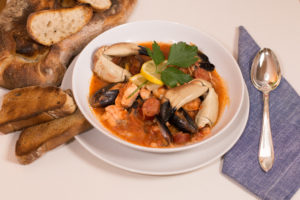 A nice bowl of Cioppino, loaded with seafood.