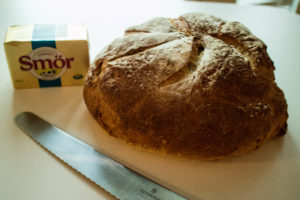 A fresh loaf of sourdough bread awaiting the Cioppino.