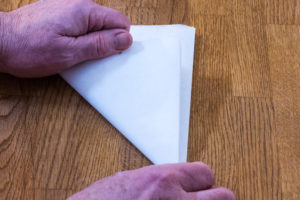 Step 3: Fold your cartouche paper again forming a triangle.