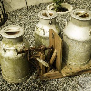 Antique milk cans and scale.