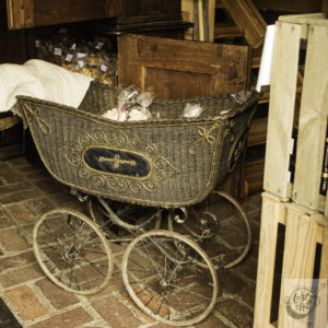 An antique baby buggy loaded with bags of sweet baked meringues.