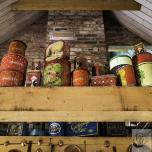 Antique food tins for coffee, biscuits and other food items.