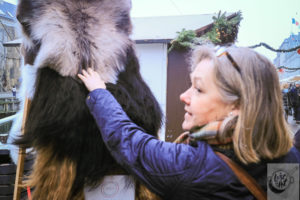 Eva inspecting fur pelts.
